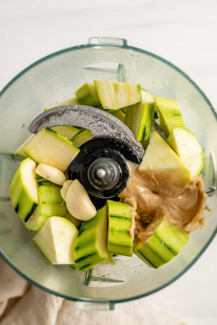 Chopped zucchini, garlic and tahini in a food processor.