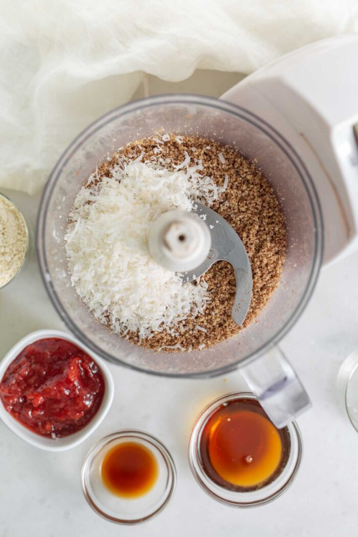 Coconut and pecans in a food processor.
