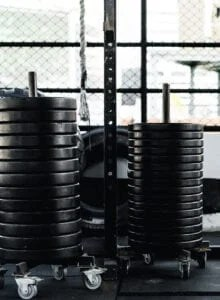 Two stacks of 25 lb weight plates in a gym.