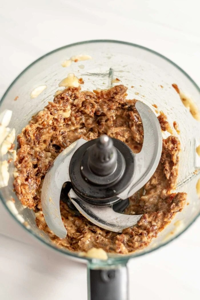 A date and banana mixture blended up in a food processor.