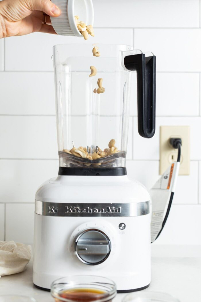 Add cashews to a blender.