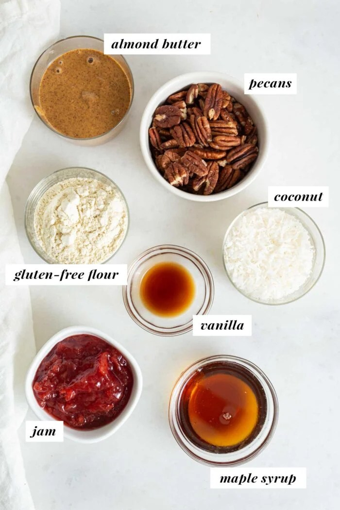 Various baking ingredients in small bowls with labels.