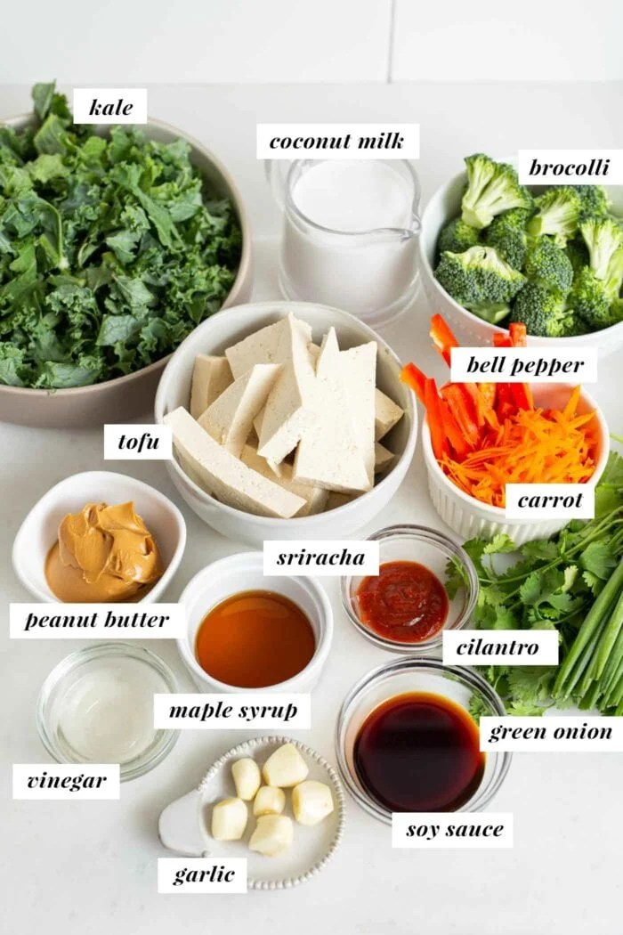 Labelled ingredients for a tofu kale broccoli salad with peanut sauce.