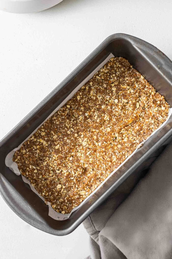 Energy bars in a parchment paper-lined loaf pan.