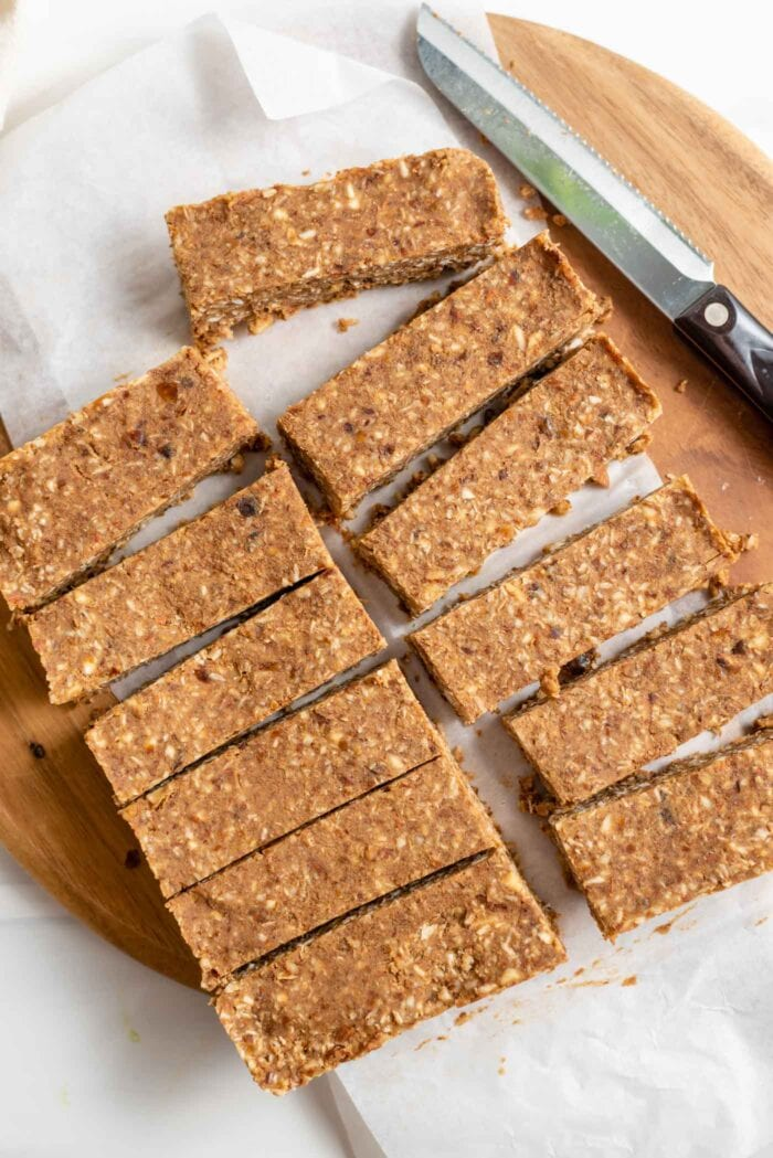 10 sliced energy bars on a cutting board. Knife rests beside bars.