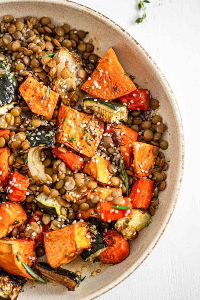 Overhead image of a bowl of roasted vegetables and lentils.