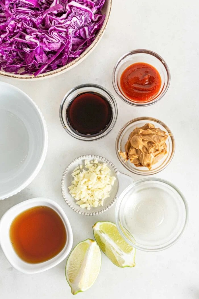 Overhead image of various ingredients in small dishes for making a spicy peanut sauce.