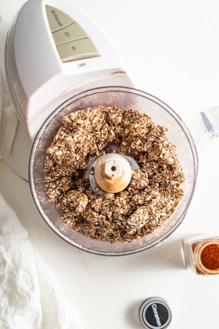 Blended dates and oats in a food processor.