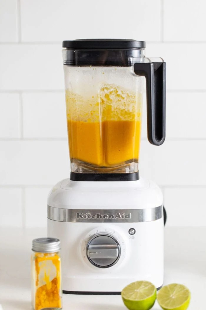 Creamy, blended sweet potato soup in a KitchenAid blender.