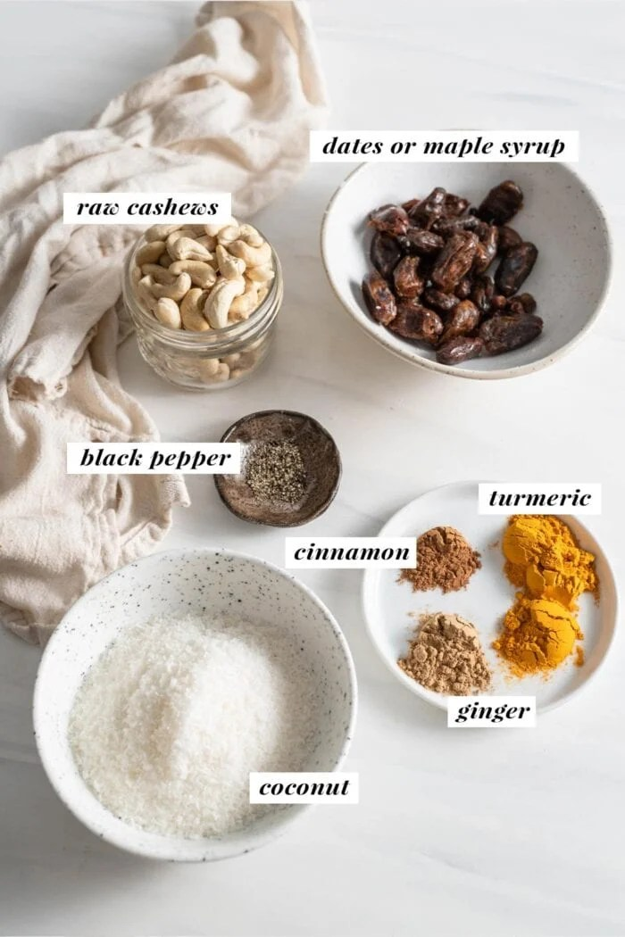 Coconut, dates, cashews and various spices labelled with text overall.