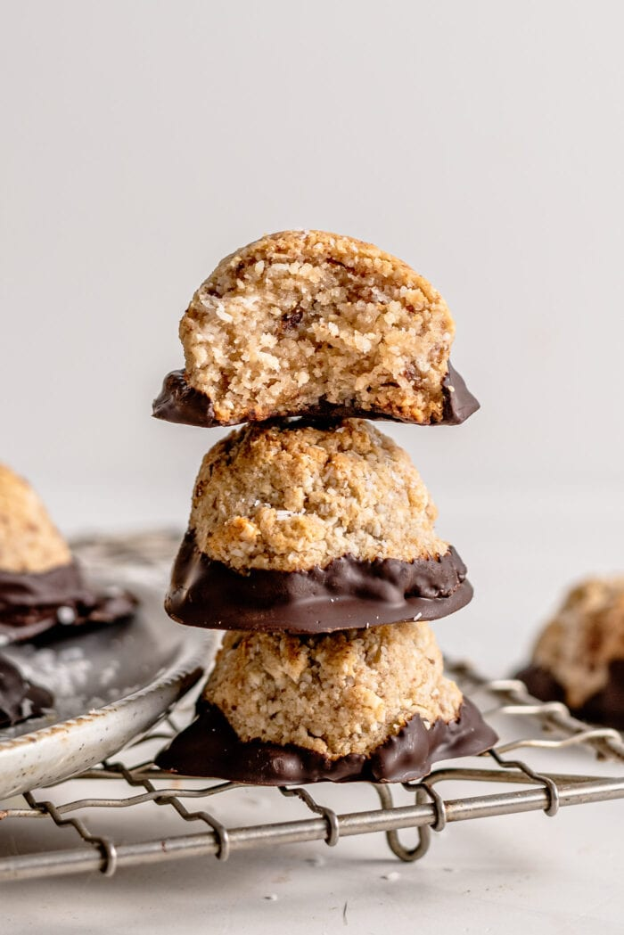 Stack of 3 coconut macaroons sitting on a cooling rack.