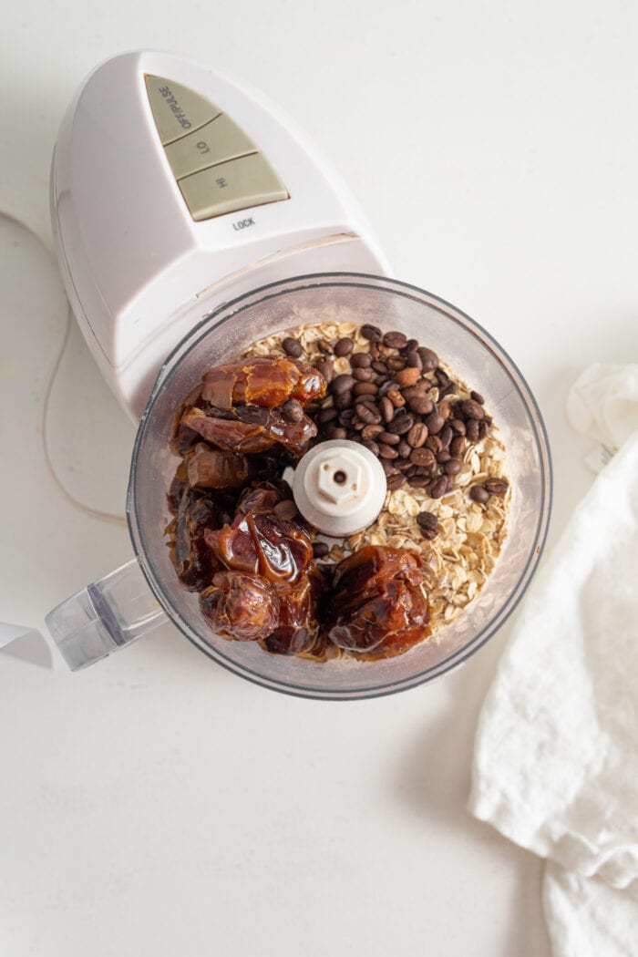 Dates, oats, coffee beans and vanilla in a food processor.