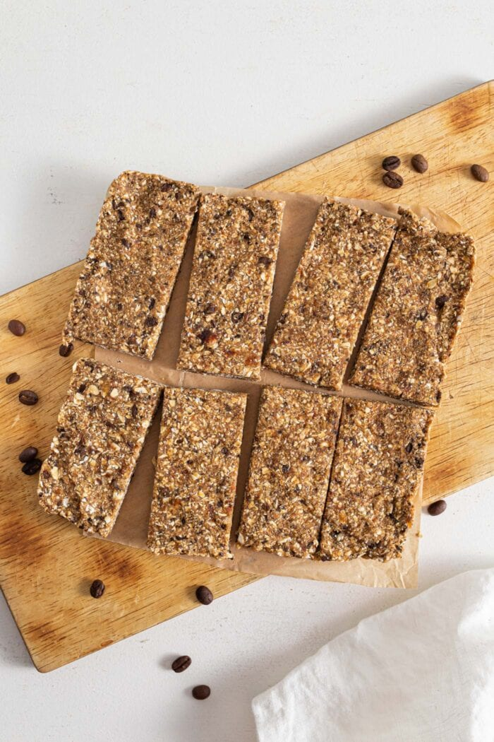 Energy bars cut into 8 portions on cutting board.