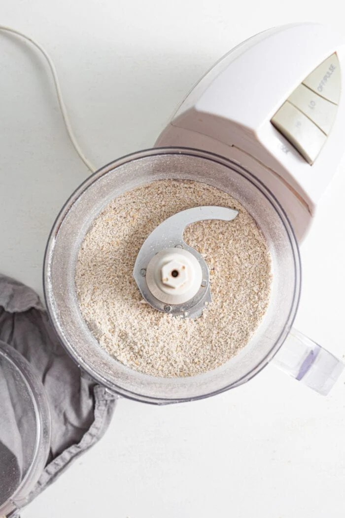 Oats mixed with flour in a food processor.