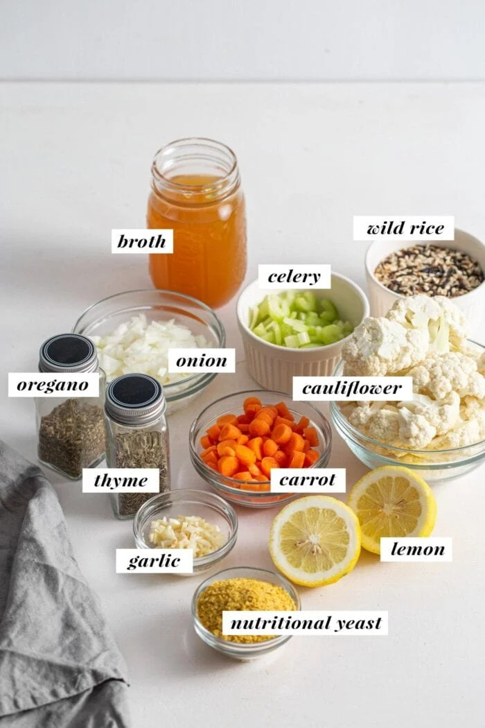 Visual of all the ingredients needed to make a wild rice soup with cauliflower.  The ingredients are labeled with a text overlay.