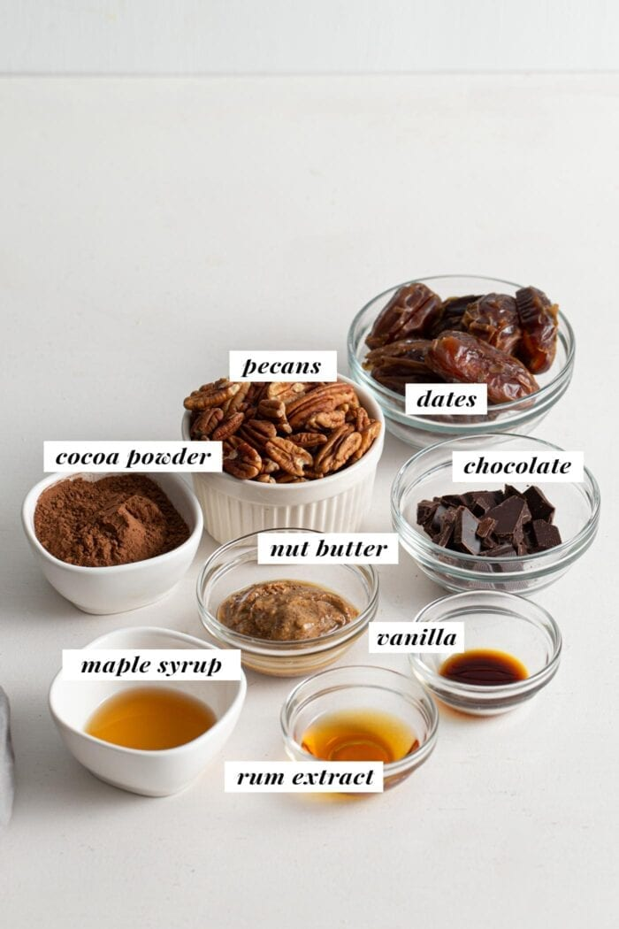 Visual of ingredient list for healthy vegan rum balls recipe.