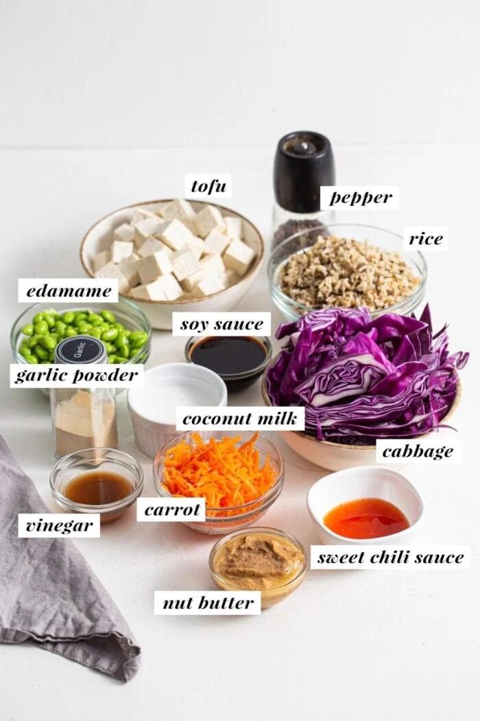 Ingredients labeled for making an edamame tofu buddha bowl.