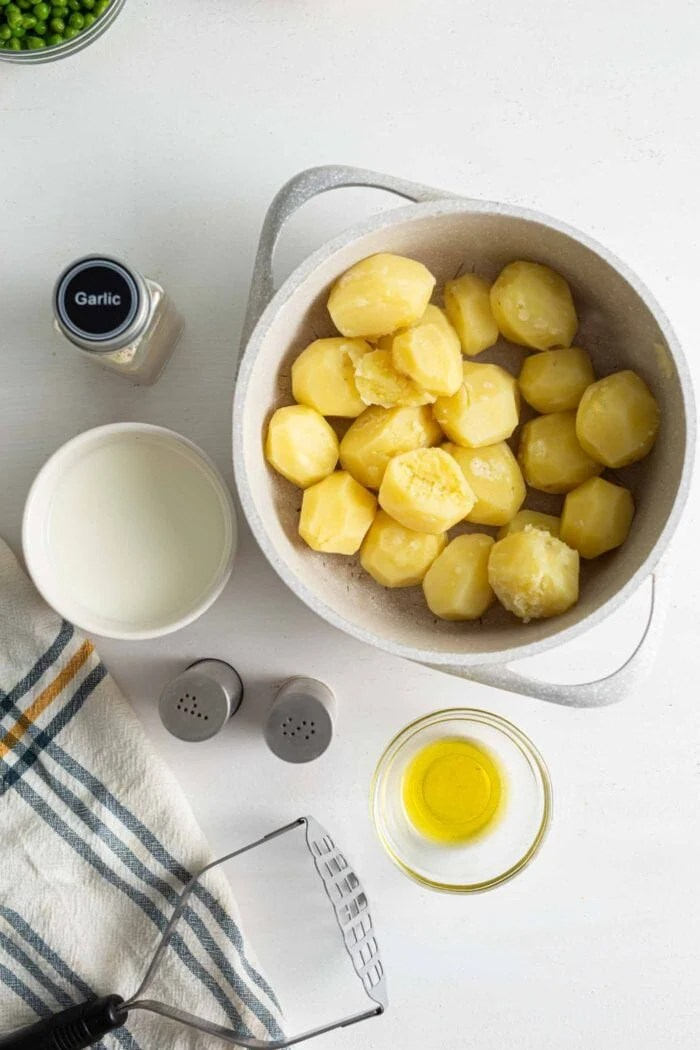 Pot of peeled, cooked chunks of yellow potato.