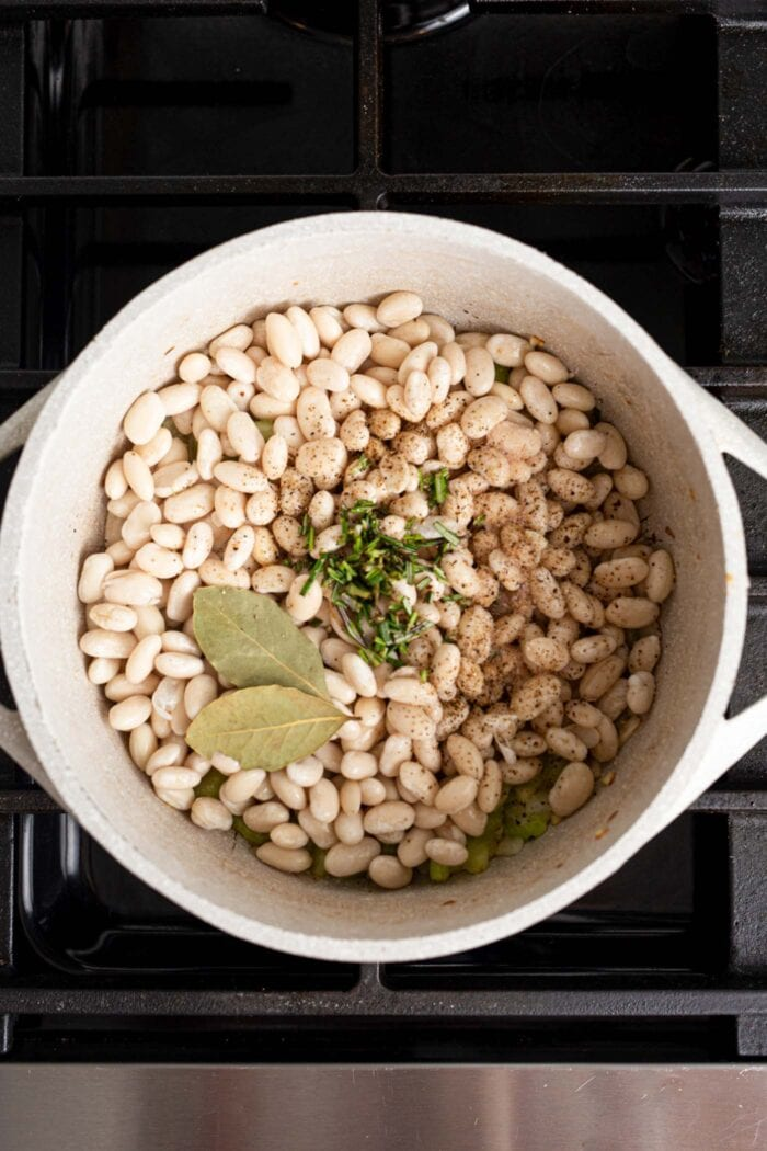A pot of white beans, bay leaves