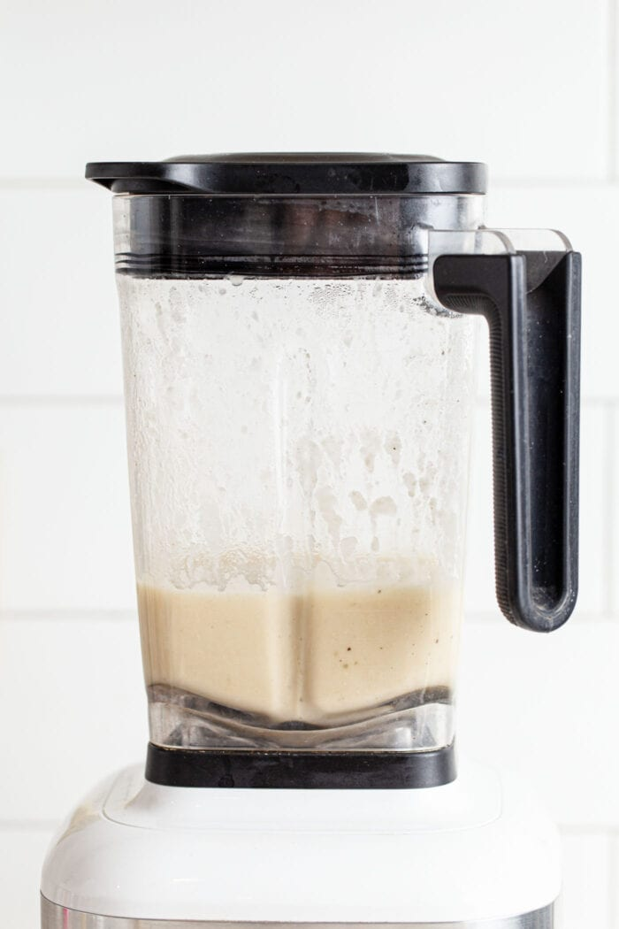 Blended creamy white bean soup in a blender.
