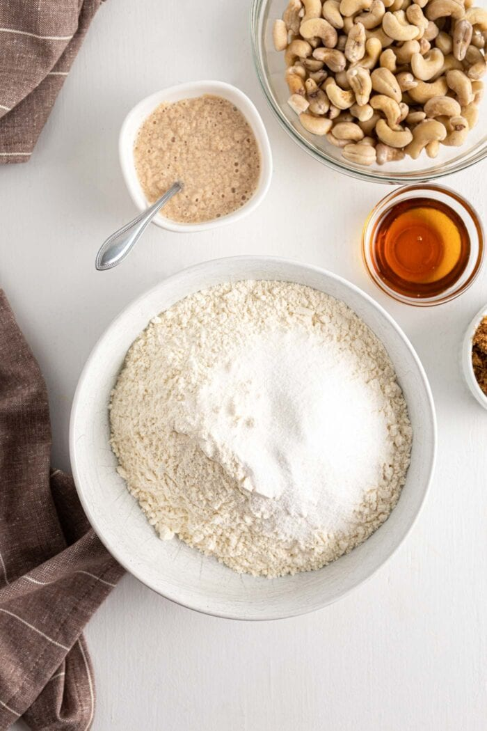 Flour and sugar mixed together in a mixing bowl.