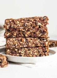 Stack of 4 energy bars on a small plate.
