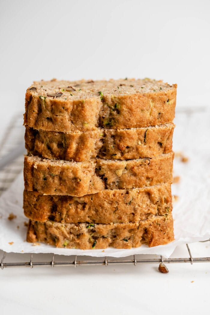 Close up of a stack of 5 thick slices of zucchini bread.