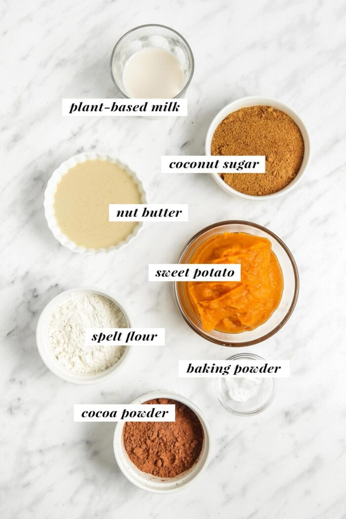 Visual of all ingredients needed for making healthy sweet potato brownies. Each ingredient is labelled with text.