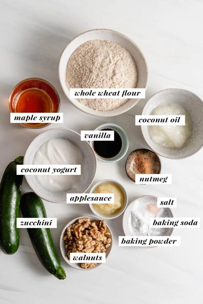 Visual of all ingredients needed for making a zucchini loaf labelled with text overlay.