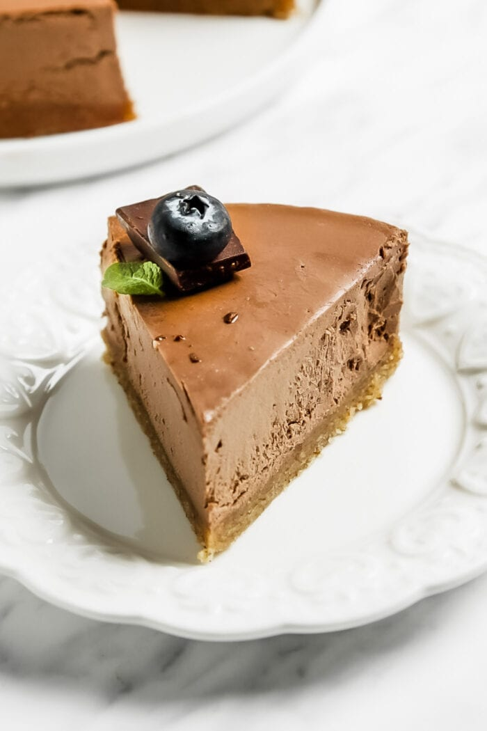Slice of chocolate cheesecake on a small plate.
