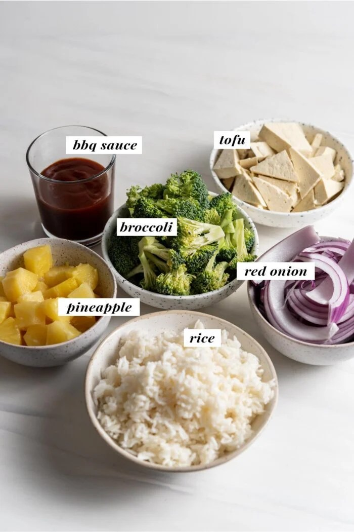 Visual of ingredients needed for making bbq tofu bowls. Each ingredient is labelled with text overlay.