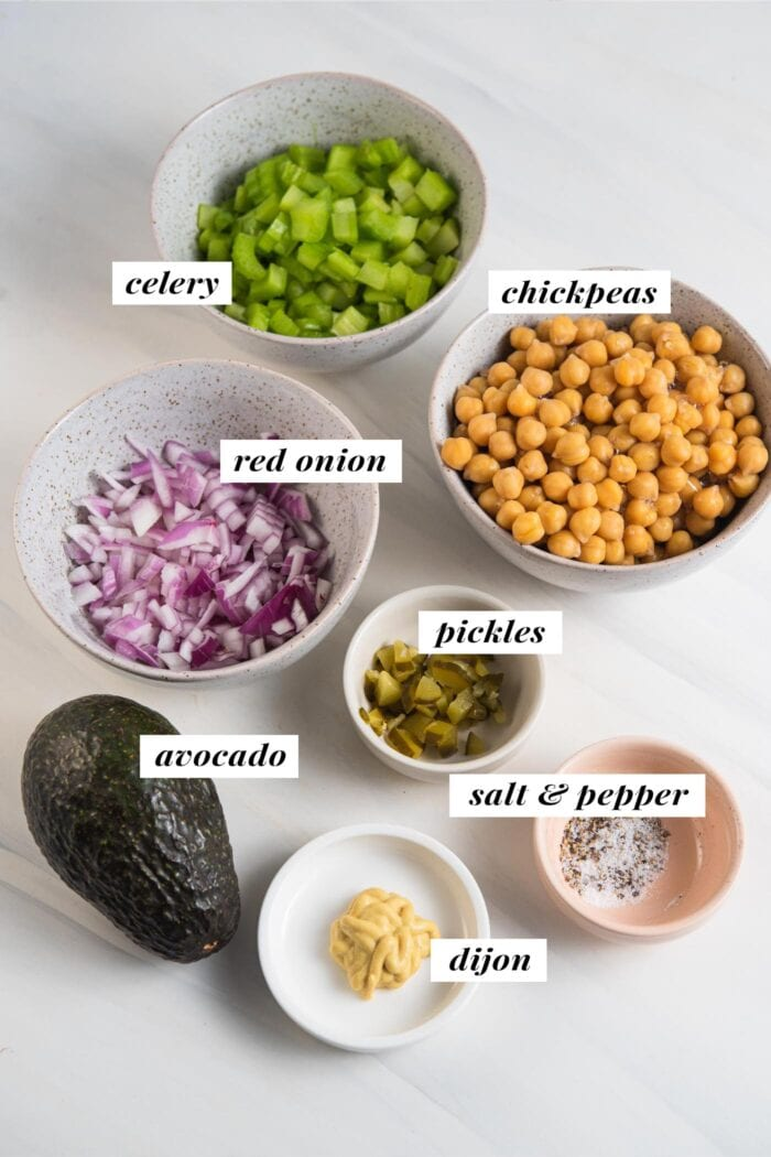 Visual of ingredients needed for making chickpea salad, each ingredient labelled with text.