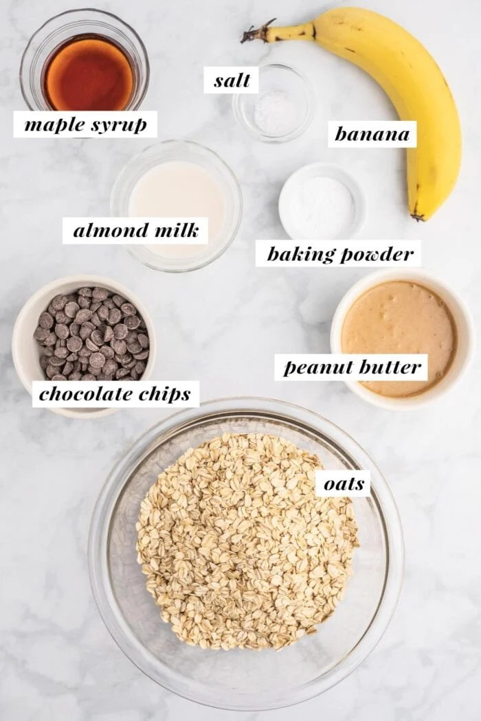 Visual of all ingredients needed for making peanut butter oatmeal chocolate chip cookies.