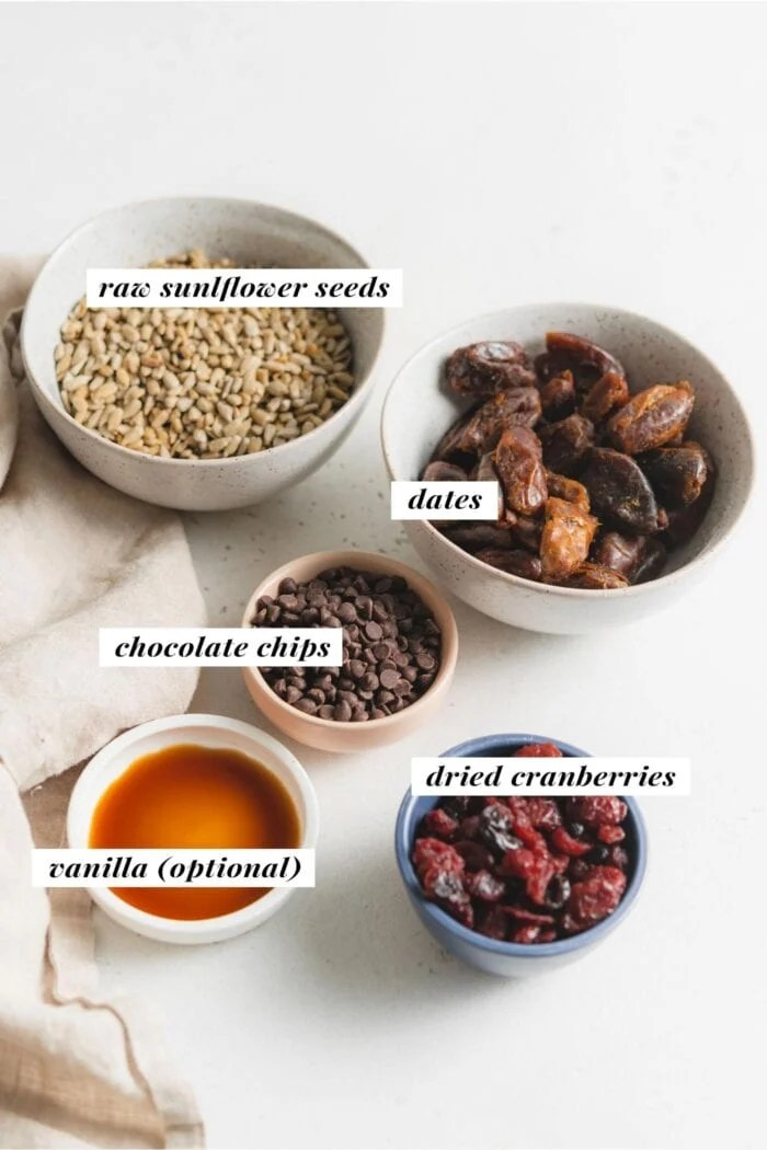 Visual of ingredients needed for making sunflower seed energy balls, each ingredient is labelled with text overlay.