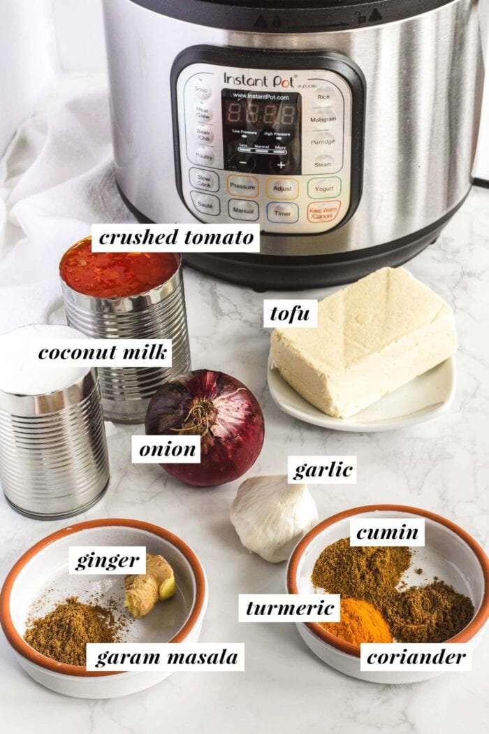 Visual list of ingredients needed for making a tofu tikka masala recipe.