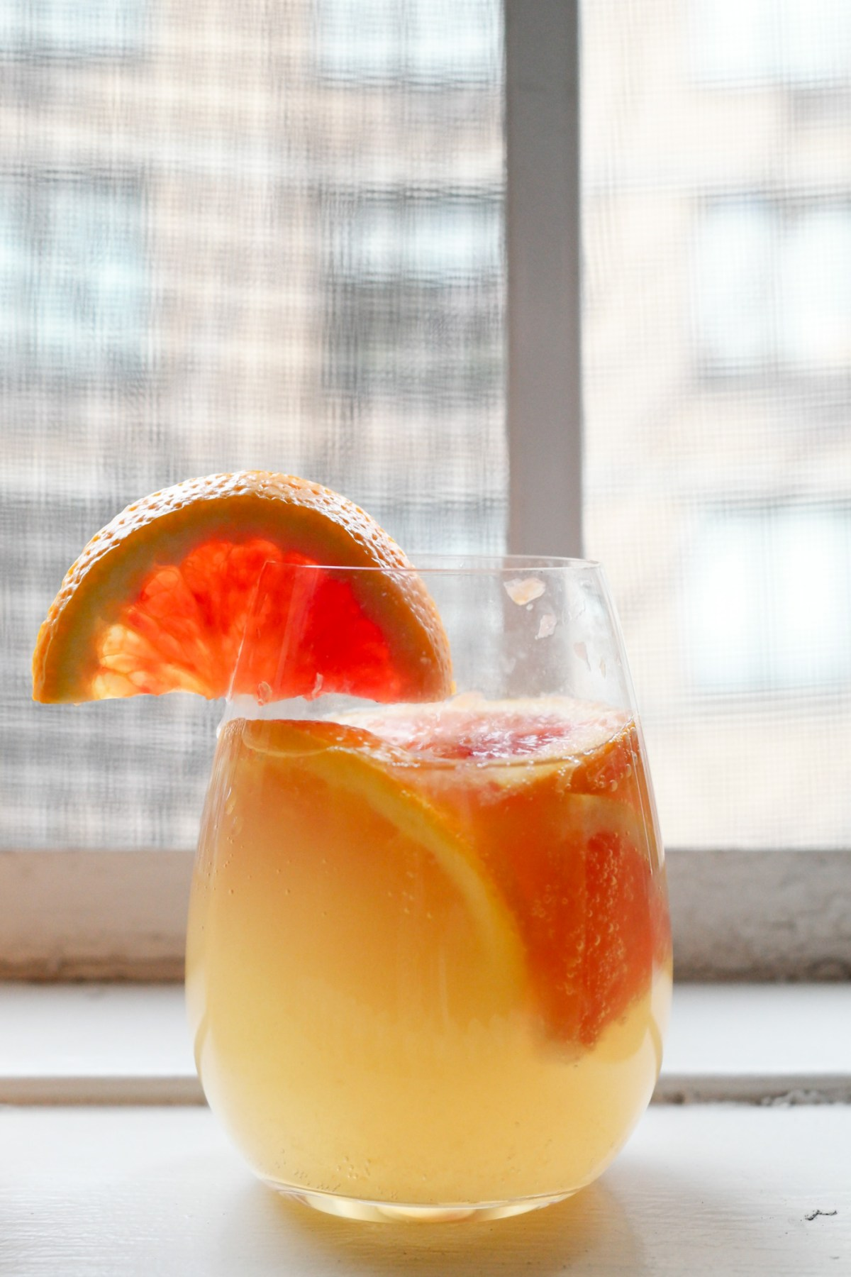 LOOK AT THAT GLASS! SO BRIGHT AND COLORFUL AND DELICIOUS. and just make this white citrus sangria because YUM.   thepikeplacekitchen.com