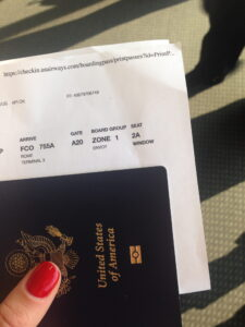 Passport checked, boarding pass ready, Zone 1, Seat 2A