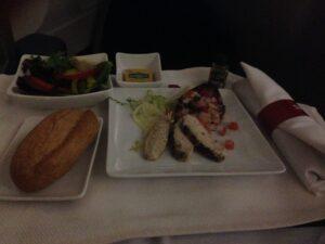 Appetizer course, Sliced pesto chicken breast with tomato-caper relish, salad & hot rolls