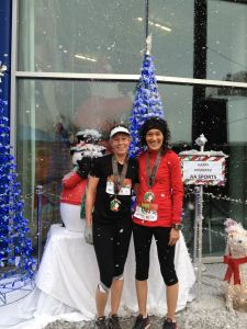 Two Holiday Half Marathon participants take advantage of the AA Sports Photo Op