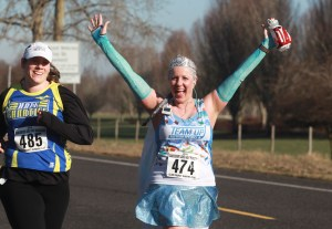 Mary Verdeccia (R), cheers as she wears a princess outfit as she participates in the annual Vancouver Lake Half Marathon Sunday January 26, 2014. (Natalie Behring/for the Columbian)