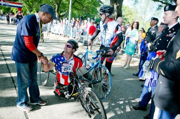 Boston Marathon winner Meb Keflezighi congratulates John Masson after he crosses the finish line Photo Credit: Ashley Cross