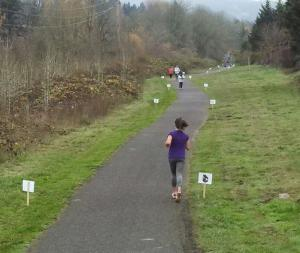 Part of the course on paved THPRD path, complete with signs representing all our participating nonprofits.