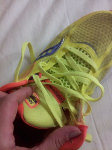 Women's Kinvara 5, bright yellow showing the 'PRO-Lock Sytem' see the little V? I think that is what can bunch up if not secured.