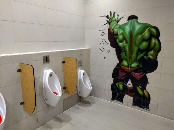 the avengers hulk pees in a restroom - movie theater mural