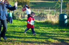 3 Year old Luke Evangelista crossing the finish line of the kids race
