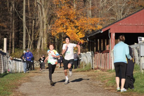 Eamonn Sullivan and Casey Wolff battle it out in the home stretch of the kids race.