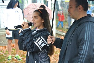 """Victoria Dennis singing """"America the Beautiful"""" before the start of the kids races. (photo by John Cummings)"""