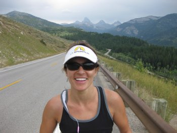 """Mindy climbing up the """"road section"""" with the beautiful tetons in the background."""