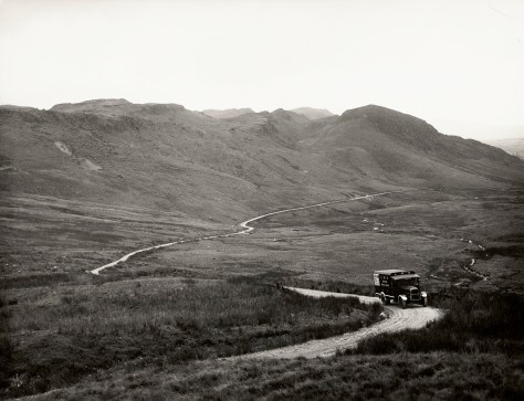 An LMS van on a single track road amongst hills, transporting National Gallery paintings to Manod Quarry during World War II.