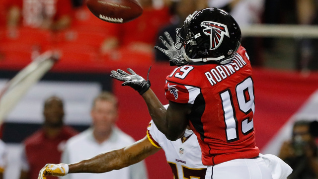 ATLANTA, GA - AUGUST 11: Aldrick Robinson #19 of the Atlanta Falcons pulls in this reception against Quinton Dunbar #47 of the Washington Redskins at Georgia Dome on August 11, 2016 in Atlanta, Georgia. (Photo by Kevin C. Cox/Getty Images)
